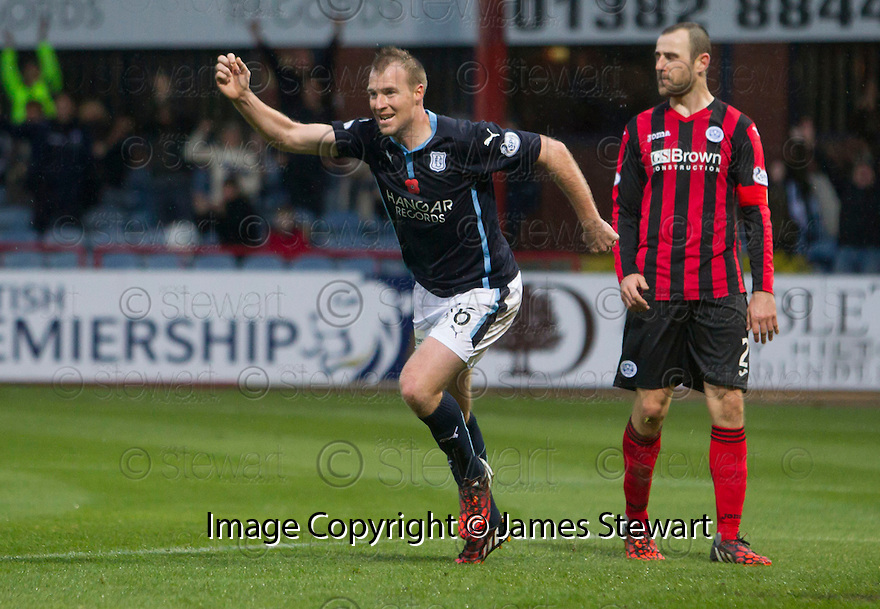 Dundee's David Clarkson celebrates after he scores.