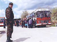 Kosovar refugees who just crossed the border into Macedonia get on a bus to a refugee camp arranged by the Macedonian government.