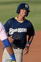 Angel Ortega (10) of the Helena Brewers hustles towards third base against the Ogden Raptors at Lindquist Field in Ogden Utah on July 20, 2013.  (Stephen Smith/Four Seam Images)