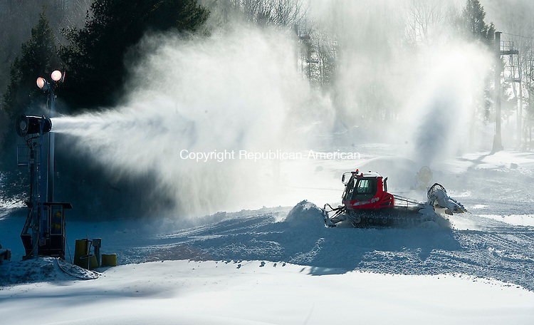 CORNWALL, CT--- -010516JS0504--A worker at Mohawk Mountain Ski Area in Cornwall, uses a snow machine to groom the snow on a trail while the snow makers coat the area with snow. Despite the warm temperatures this season, the area still had two ski trails open. With the new snow produced, and snow makers running around the clock, they are hoping to be at 100 percent open very soon.  Jim Shannon Republican-American