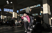 Pictured: A young migrant mother with her child Monday 22 February 2016<br /> Re: Thousands of migrants, most from Syria, have landed to the port of Pireaus, after crossing the border from Turkey to various islands like Lesvos and Kos in Greece.