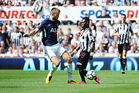 Eric Dier of Tottenham Hotspur tackles Christian Atsu of Newcastle United during Newcastle United vs Tottenham Hotspur, Premier League Football at St. James' Park on 13th August 2017