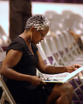 Newsday Reporter, Katie Gray, on the job at event of Pastor Donnie McClurkin preaching at Bible Study with his congregation at the Perfecting Faith Church in Freeport on Wednesday August 18, 2004. (Newsday Photo / Jim Peppler).
