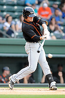 Infielder Creede Simpson (9) of the Delmarva Shorebirds bats in a game against the Greenville Drive on Friday, April 26, 2013, at Fluor Field at the West End in Greenville, South Carolina. Delmarva won, 10-3. (Tom Priddy/Four Seam Images)