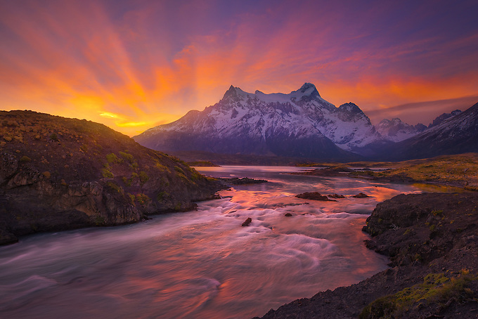 The Salto Grande River reflects a brilliant sunset towards Paine Grande.
