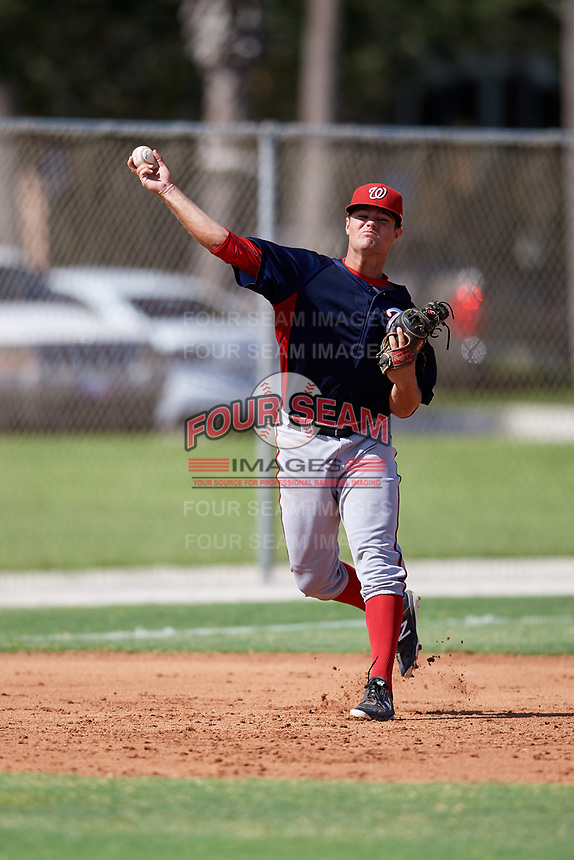 GCL Nationals third baseman Colton Pogue (10) throws to first base during a game against the GCL Cardinals on August 5, 2018 at Roger Dean Chevrolet Stadium in Jupiter, Florida.  GCL Cardinals defeated GCL Nationals 17-7.  (Mike Janes/Four Seam Images)