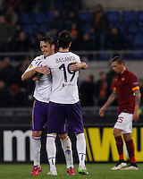 Calcio, Europa League: Ritorno degli ottavi di finale Roma vs Fiorentina. Roma, stadio Olimpico, 19 marzo 2015.<br /> Fiorentina's Gonzalo Rodriguez, left, and Jose' Basanta celebrate at the end of the Europa League round of 16 second leg football match between Roma and Fiorentina at Rome's Olympic stadium, 19 March 2015. Fiorentina won 3-0.<br /> UPDATE IMAGES PRESS/Isabella Bonotto