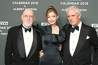 Marco TRONCHETTI PROVERO,Gigi HADID,Albert WATSON,R_L,at the red carpet of the Pirelli Calendar launch 2019,Hangar Biccoca,MILANO,05.12.2018 Credit: Action Press/MediaPunch ***FOR USA ONLY***