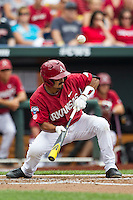 Arkansas Razorbacks shortstop Michael Bernal (3) attempts to lay down a sacrafice bunt against the Virginia Cavaliers in Game 1 of the NCAA College World Series on June 13, 2015 at TD Ameritrade Park in Omaha, Nebraska. Virginia defeated Arkansas 5-3. (Andrew Woolley/Four Seam Images)