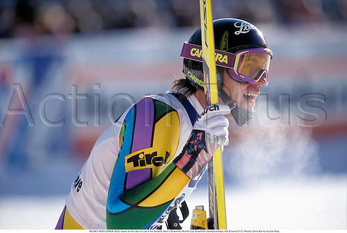 HELMUT HOEFLEHNER (AUS) leans on his skis to catch his breath, Men's Downhill, World Cup Downhill Skiing Championships, Val D'Isere, France 9112. Photo: Chris Barry/Action Plus....1991.ski.skier.skiers.alpine skiing.winter sport.winter sports.wintersport.wintersports.breath vapour.exhausted.exhaustion.tire.tired.knackered.fatigued.weariness.weary.tiredness