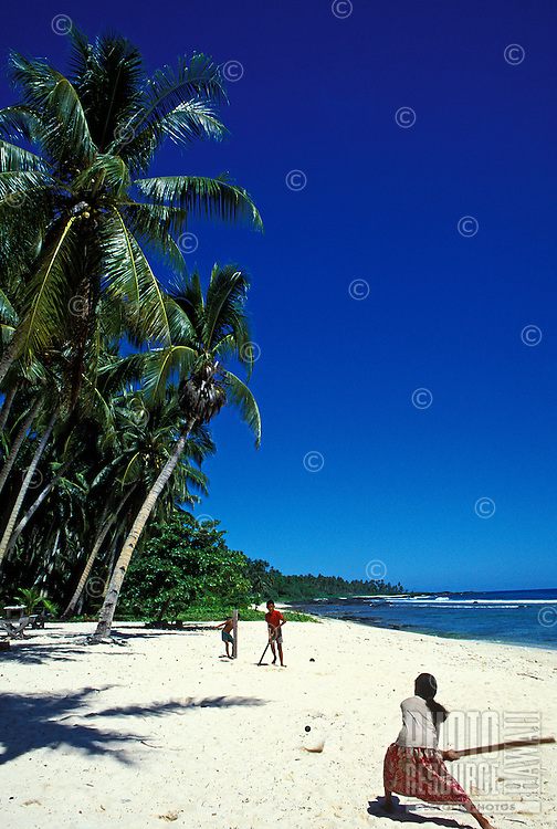 Kids play cricket on beach. Savaii, Western Samoa