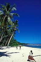 Kids play cricket on beach. Savaii, Western Samoa