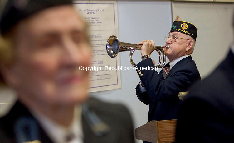 WOODBURY, CT. 10 November 2010-111010SV07--Vincent DaGrosa, commander of Heritage Village American Legion Memorial Post 204, plays Taps during the Mitchell School&rsquo;s Veterans Day ceremony with visiting veterans in Woodbury Wednesday. <br /> Steven Valenti Republican-American