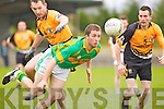 Michael Brosnahan of Knocknagoshel races for the loose ball against Asdee's David O'Connor and Brian Coughlan last Saturday in the Novice Club Championship in Knocknagoshal.