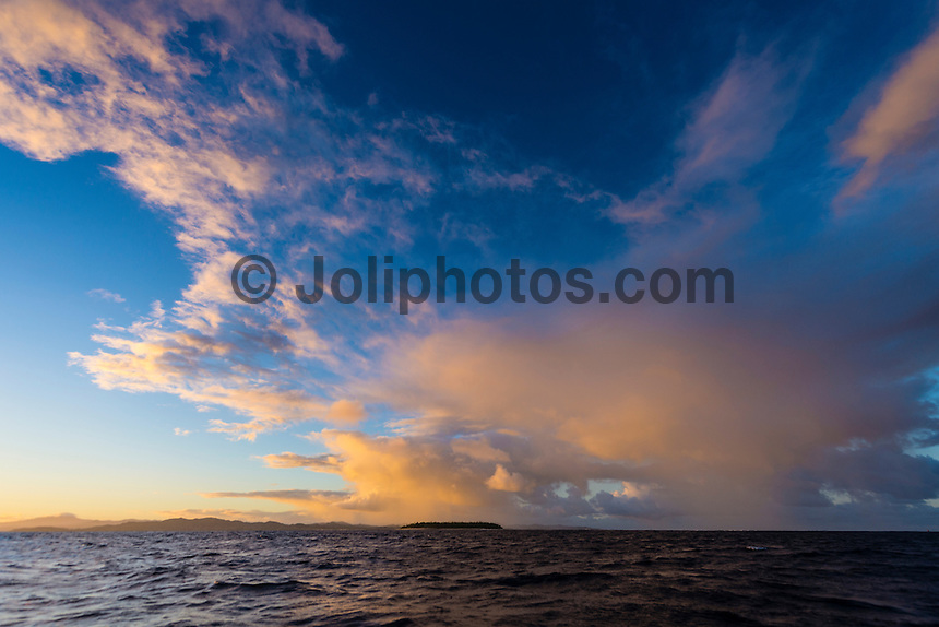 Namotu Island Resort, Namotu, Fiji. (Tuesday May 20, 2014) A rain squail heading to Tavarua Is at sunrise. – There were light winds early today with sunshine and the odd passing shower producing rainbows on and off all morning. There were small wave sessions at Cloudbreak and Namotu Lefts for some of the guests. Photo: joliphotos.com