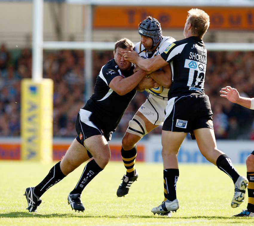 Photo: Richard Lane/Richard Lane Photography. Exeter Chiefs v London Wasps. Aviva Premiership. 25/09/2011. Wasps' Marco Wentzel is tackled by Exeter's Brett Sturgess and Jason Shoemark.