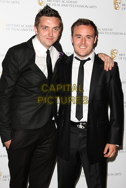CRAIG GAZEY & ALAN HALSALL.British Academy Television Craft Awards at the Hilton, Park Lane, London, England, UK, May 23rd 2010.BAFTA half length black suit tie white shirt arm around .CAP/ROS.©Steve Ross/Capital Pictures