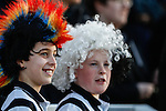 Grimsby Town fans wearing wigs during the Vanamara Conference League match between Woking and Grimsby Town at the Kingfield Stadium, Woking, Surrey<br /> Picture by David Horn/eXtreme aperture photography +44 7545 970036<br /> 07/03/2015