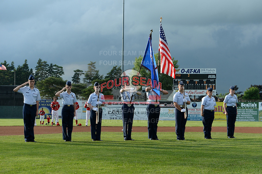 Batavia Muckdogs flag presentation during the national anthem before a game against the State College Spikes on July 3, 2014 at Dwyer Stadium in Batavia, New York.  State College defeated Batavia 7-1.  (Mike Janes/Four Seam Images)