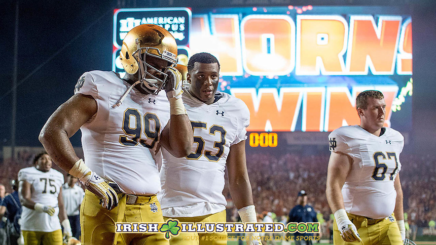 Defensive lineman Jerry Tillery (99) and defensive lineman Khalid Kareem (53) leave the field.