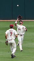 NWA Democrat-Gazette/CHARLIE KAIJO Arkansas Razorbacks outfielder Dominic Fletcher (24) makes a catch during game two of the College Baseball Super Regional, Sunday, June 9, 2019 at Baum-Walker Stadium in Fayetteville. Ole Miss forces a game three with a 13-5 win over the Razorbacks