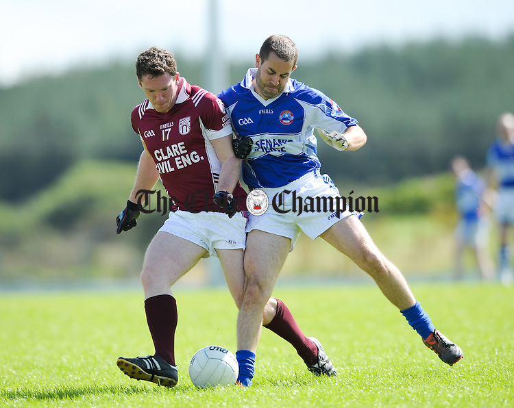 Greg Lyons of Doora Barefield in action against Brendan Smith of Kilkee during their senior football championship round 2 game at Kilmihil. Photograph by John Kelly.