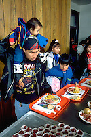 Native American family getting Christmas dinner at soup kitchen.  St Paul  Minnesota USA