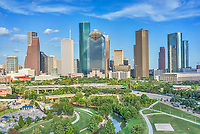 Houston Skyline Aerial -  This is a aerial view over Houston Skyline with the Buffalo Bayou, Elenor Tinsley Park and the Jaimal Skate Park all in the image below. You can also see the Sabine St. Bridge along with the Allen Parkway and on the other side is Memorial dirve running along the other side of the park.  The city view includes the usual skyscrapers like the Chase Tower, Heritage Plaza, Wells Fargo, and the 1400 Smith St. buildings just to name a few.  You can see the Houston City Hall building at the base of the buildings where it is dwarfed by the high-rise skyscrapers since Houston has some ot the tallest buildings in the southern US. We were able to capture this high quality aerial image because we use a full frame camera on our drone for out still photographs so we can get the best image which can be printed easlity as a 40 x 60 or larger size without loss of resolution.​