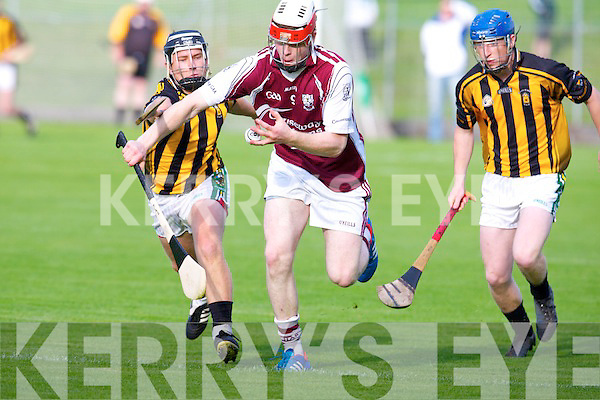 Abbeydorney's Brendan O'Leary tries to stop Causeway's Muiris Delaney in the quarter final of the hurling senior championship at Austin Stack park, Tralee on Monday.