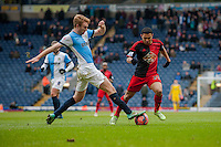 BLACKBURN, ENGLAND - JANUARY 24: Chris Taylor of Blackburn Rovers  takes the ball from underneath Jefferson Montero of Swansea City    during the FA Cup Fourth Round match between Blackburn Rovers and Swansea City at Ewood park on January 24, 2015 in Blackburn, England.  (Photo by Athena Pictures/Getty Images)