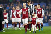 11th January 2020; Stamford Bridge, London, England; English Premier League Football, Chelsea versus Burnley; Ben Mee of Burnley leading out his team mates - Strictly Editorial Use Only. No use with unauthorized audio, video, data, fixture lists, club/league logos or 'live' services. Online in-match use limited to 120 images, no video emulation. No use in betting, games or single club/league/player publications