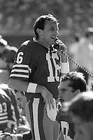 SAN FRANCISCO, CA - Quarterback Joe Montana of the San Francisco 49ers talks on the phone during a game against the St. Louis Cardinals at Candlestick Park in San Francisco, California in 1986. Photo by Brad Mangin