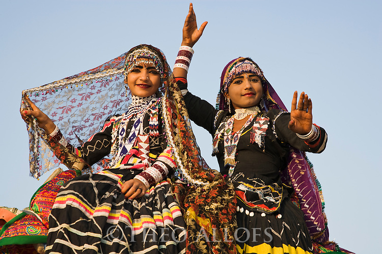 Rajasthani dancers in traditional costumes performing; Rajasthan, India --- Model Released