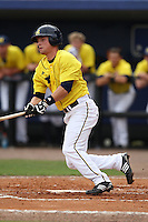 March 21, 2010:  Right Fielder Nick Urban (9) of the Michigan Wolverines at bat during a game at Tradition Field in St. Lucie, FL.  Photo By Mike Janes/Four Seam Images