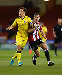 Paul Coutts of Sheffield Utd tussles with Tom Lockyer of Bristol Rovers during the League One match at Bramall Lane Stadium, Sheffield. Picture date: September 27th, 2016. Pic Simon Bellis/Sportimage