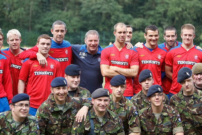Ally McCoist and Rangers players with members of 1 Medical Regiment based in Münster, Germany