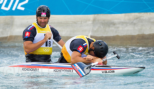 02 AUG 2012 - CHESHUNT, GBR - Pavol Hochschorner (SVK) (right) and Peter Hochschorner (SVK) (left) of Slovakia recover after finishing their final run in the men's Canoe Double (C2) during the London 2012 Olympic Games final at Lee Valley White Water Centre, Cheshunt, Great Britain (PHOTO (C) 2012 NIGEL FARROW)