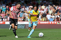 Ryan Williams of Rotherham tries to outpace Brentford's Henrik Dalsgaard during Brentford vs Rotherham United, Sky Bet EFL Championship Football at Griffin Park on 4th August 2018