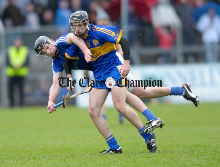 Shane O Brien of Newmarket On Fergus in action against Michael Hawes of Cratloe during the senior county hurling final at Cusack Park. Photograph by John Kelly.