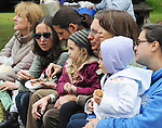 """Audience members enjoying the Arm-of-the-Sea Theater's, presentation of it's new play """"DIRT,"""" that tells the story of how Garlic came to the area, at the 27th Annual Hudson Valley Garlic Festival, held in Cantine Memorial Field, in Saugerties, NY, on Saturday, October 1, 2016. Photo by Jim Peppler; Copyright Jim Peppler 2016."""