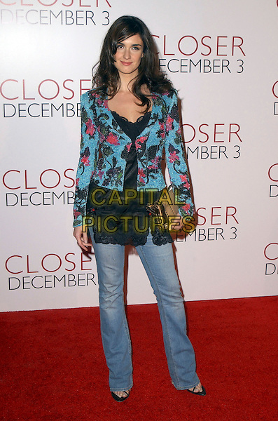 "PAZ VEGA.Attends The Columbia Pictures' Premiere of ""Closer"" held at The Mann Village Theatre in Westwood, California, USA, November 22nd 2004.full length black lace camisole slip over jeans blue turquoise floral flower patterned cardigan.Ref: DVS.www.capitalpictures.com.sales@capitalpictures.com.©Debbie VanStory/Capital Pictures ."