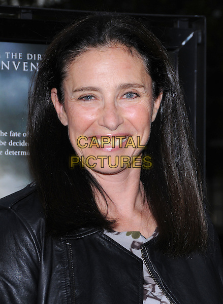 "MIMI ROGERS .attends Paramount Pictures' L.A. Premiere of ""Waiting for Superman"" held at Paramount Theatre in Hollywood, California, USA, September 20th 2010..portrait headshot smiling  black leather jacket .CAP/RKE/DVS.©DVS/RockinExposures/Capital Pictures."