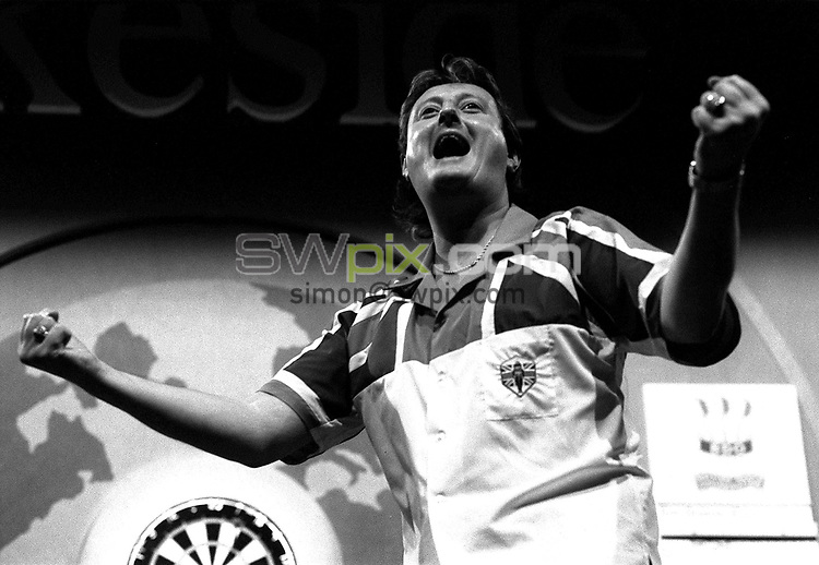 Pix: Michael Steele/SWpix.com. Embassy World Darts. Frimley Green, Essex. 1992...COPYWRIGHT PICTURE>>SIMON WILKINSON>>01943 436649>>..Darts legend Eric Bristow celebrtaes another World title.