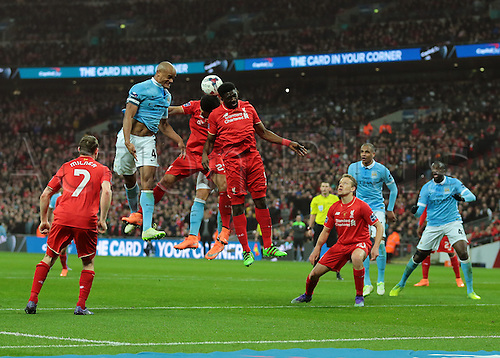 28.02.2016. Wembley Stadium, London, England. Capital One Cup Final. Manchester City versus Liverpool. Manchester City Defender Vincent Kompany wins a climbing header from a Manchester City corner
