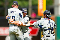 Georgia Tech Yellow Jackets teammates Jake Davies #24, Zane Evans #10 and Connor Lynch #16 meet on the mound to celebrate their win over the Miami Hurricanes at the 2012 ACC Baseball Championship at NewBridge Bank Park on May 27, 2012 in Winston-Salem, North Carolina.  The Yellow Jackets defeated the Hurricanes 8-5.  (Brian Westerholt/Four Seam Images)