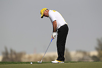 Damien McGrane (IRL) takes his putt on the 12th green during Friday's Round 3 of the Commercial Bank Qatar Masters 2013 at Doha Golf Club, Doha, Qatar 25th January 2013 .Photo Eoin Clarke/www.golffile.ie