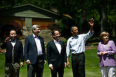 (L-R) Japanese Prime Minister Yoshihiko Noda, Canadian Prime Minister Stephen Harper, French President Francois Hollande, U.S. President Barack Obama and German Chancellor Angela Merkel pose for a family photo during the 2012 G8 Summit at Camp David May 19, 2012 in Camp David, Maryland. Leaders of eight of the worlds largest economies meet over the weekend in an effort to keep the lingering European debt crisis from spinning out of control.  .Credit: Luke Sharrett / The New York Times / Pool via CNP