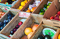 Rustic fruit crates on display at a farmers market.