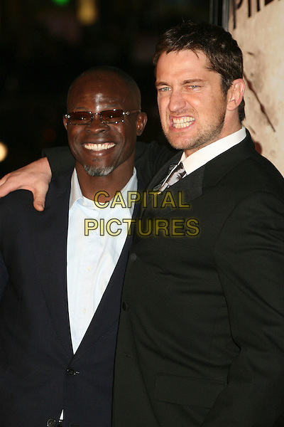 "DJIMON HOUNSOU & GERARD BUTLER.""300"" Los Angeles Premiere at Grauman's Chinese Theatre, Hollywood, California, USA..March 5th, 2007.half length black suit jacket beard facial hair goatee sunglasses shades teeth funny face .CAP/ADM/BP.©Byron Purvis/AdMedia/Capital Pictures"