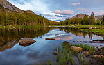 Wind River Range, WY: Calm waters and reflections at dusk from Horseshoe Lake; Lizard Head Meadows area; Popo Agie Wilderness in the Bridger National Forest in summer